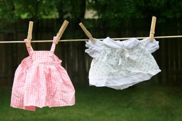Kids clothes hanging from simple clothes line