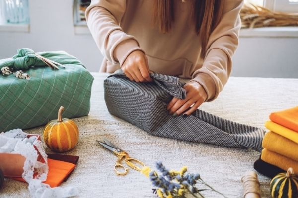 Using cloth to wrap a gift