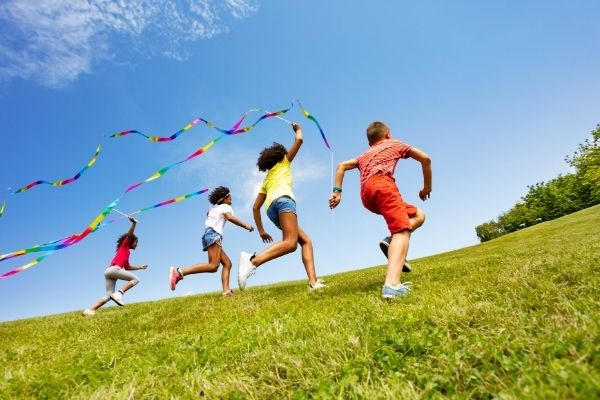 Kids playing with colorful ribbons