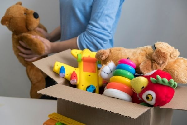 Person holding second hand toys