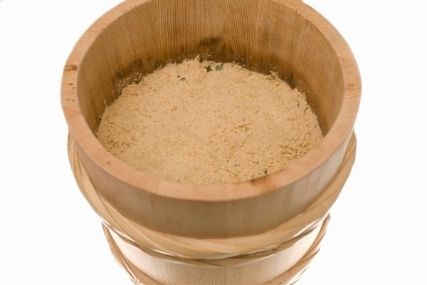 Wooden bucket filled with bran