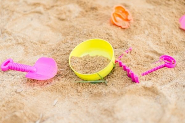 bright colored sand toys on a sandbox