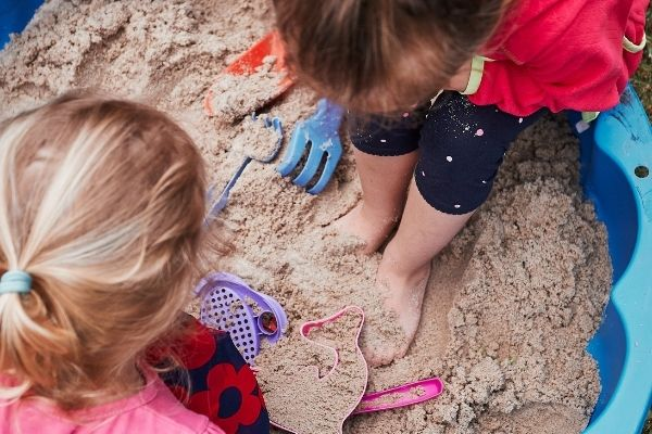 kids playing with play sand
