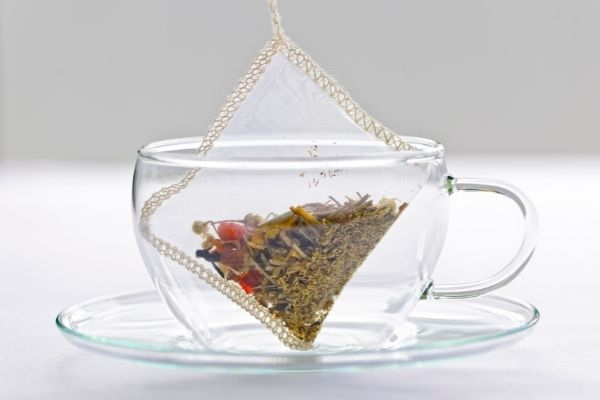 tea bag in clear glass cup