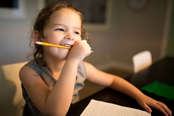 child holding a pencil