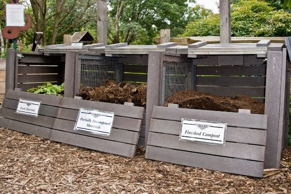 organized wooden fence compost bins