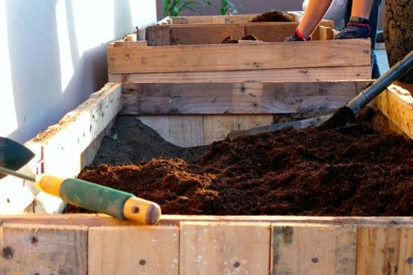 adding compost to garden beds