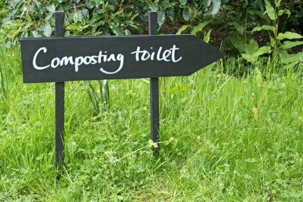 composting toilet sign outdoors
