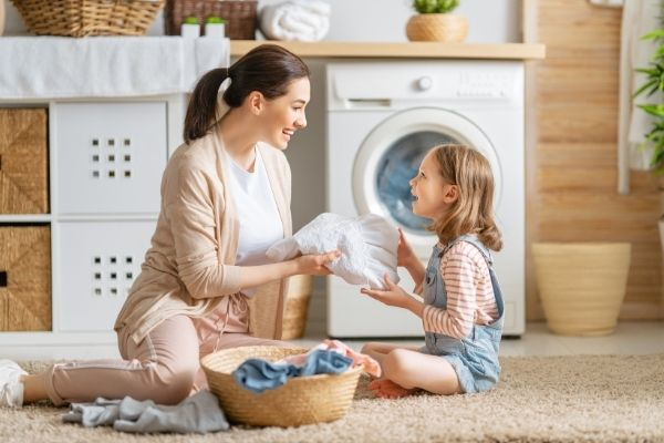 mother and daughter on laundry day