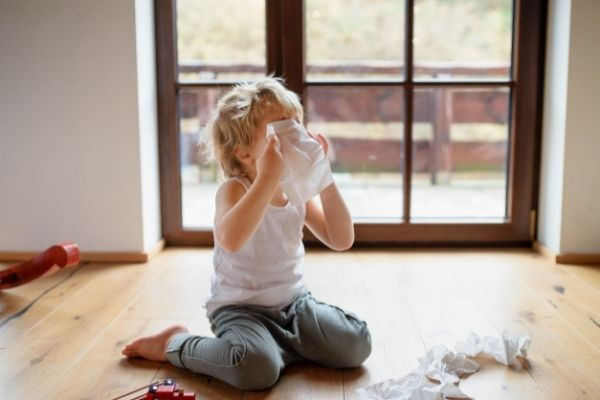 child using facial tissues